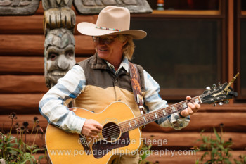 Cowboy Brad Fitch playing at a house concert